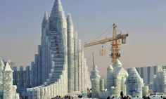 China's giant frozen castle built entirely from ICE: Enormous structure that towers over construction crane forms centrepiece of annual snow...