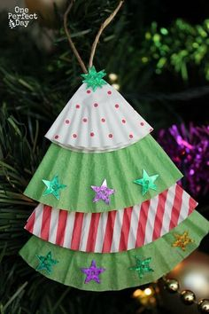 Easy Christmas ornament for kids to make using cupcake liners and some glittery stickers.