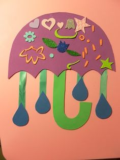 """""""April showers bring May flowers"""" Umbrella craft for Spring unit. Use foam for handle."""