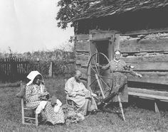 Frontier Pioneer Life....middle woman is cording the wool or cotton, one on right is spinning to make yarn and the lady in the bonnet is knitting, what appears to me are socks. Long and tedious work and you treasured every piece of clothing that was made.