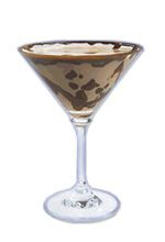 Choko Toffee Martini. The Choko Toffee Martini cocktail is made from Dooleys, vodka and a chocolate bar, and served in a cocktail glass.