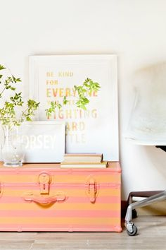 Give an old trunk a makeover with bold and bright painted stripes!