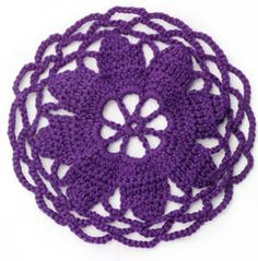 flower center circular motif.  Great for doilies, or a center of a tablecloth, afghan or for clothes
