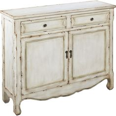 Wood cabinet with scalloped apron and curved legs.    Product: Cupboard    Construction Material: Wood