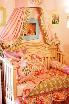 Love this bedding - esp the roll pillow for bumper