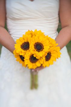 Bouquets: A simple bouquet of sunflowers makes a bold impact. - 75+ Ideas for Summer Weddings: From color palettes to centerpieces to cakes, get tons of inspiration for a summer wedding. Bridesmaids, Wedding Planning Ideas, Summer Wedding Ideas, Bridesmaid Flowers, Wedding Bouquets, Bouquet Wedding, Sunflow Bouquet, Summer Weddings, Bridesmaid Bouquets