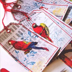 Parrots and Japanese newspaper luggage tags.