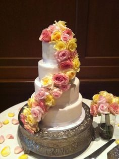 Sassy's Cafe and Bakery makes a Spring/Summer wedding cake with pretty flowers and 2 tiers! They do such a great job, located in Mesa, Arizona.