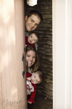 Photo tip: anything can be a fun prop during a photo shoot! Even something as boring as a door. 6 month twin girls. Family photo idea.    Magruder Photo + Design