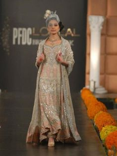 This is the image gallery of Pakistani Bridal Walima Dresses Collection 2014. You are currently viewing Pakistani Bridal Walima Dresses Collection 2014 (14). All other images from this gallery are given below. Give your comments in comments section about this. Also share stylehoster.com with your friends.   #walimadresses, #bridalwalimadresses, #bridaldresses, #pakistaniwedding
