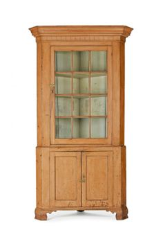 Sold $3,200 Pennsylvania painted pine and poplar two-part corner cupboard, ca. 1810, retaining an old salmon surface, 89 1/2'' h., 42'' w.