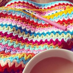 Beautiful v-stitch colorful #crochet blanket WIP from @missmotherhook