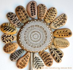 Mini pebbles with white ink on natural stone mandala