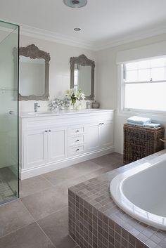 boy's bathroom.  floor tiles cut into mosaics for bath and shower base