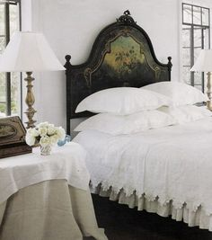 Beautiful antique headboard and lace linens
