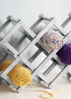 Easily store your yarn with a creative DIY Wine Knot storage unit for your craft room!