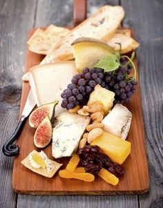 Grapes, apples, nuts, jam, french bread, brie, swiss, havarti, salami, prosciutto