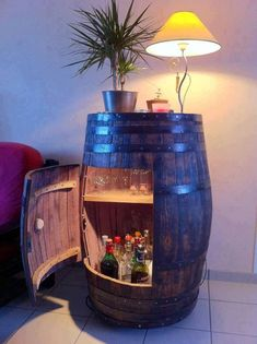 Recycle an old wine barrel as a storage cabinet.