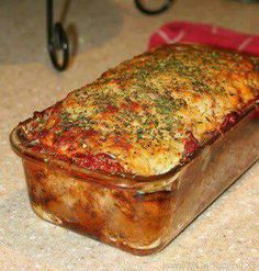THM S meal Parmesan Meatloaf  2lbs Ground Beef 1/2 cup Parm.Cheese 1/4 cup Dijon Mustard 1/2 cup low/no sugar Ketchup 1 tbs basil 1 tbs  parsley 1 tbs oregano 1 tbs thyme 1 teaspoon salt 1 tsp pepper 1/2 cup mozzarella cheese 4 cloves garlic, chopped 1 sm. onion chopped 1/2 cup spaghetti sauce  1 tbs olive oil 1 large egg, combine the ground beef, egg, seasonings, and dressings in a bowl.  Put beef, into a sprayed loaf pan.  Top with sauce & mozz.cheese.  bake 375 degrees for 45 min - 1 hour.