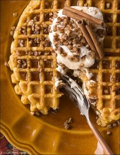 Pumpkin Waffles with Maple Whipped Cream.  Perfect treat for a fall breakfast!