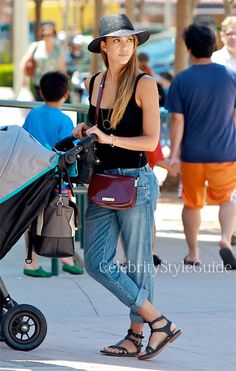 Seen on Celebrity Style Guide: Jessica Alba wore lowrise cropped boyfriend jeans out running errands in Los Angeles August 24 2013