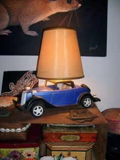 A lamp I made for the lounge room, using a very large old toy car, finished off with a vintage shade.
