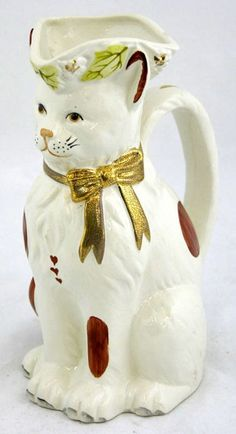 English Staffordshire Figural Cat Pitcher, 20th c., by Royale Stratford, H.- 9 3/8 in., W.- 4 3/4 in., D.- 5 1/4 in.