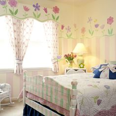 Flower Power - Softly colorwashed stripes end about 60 inches above the floor, making way for a row of flowers in pink and purple. These designs were based on the florals seen in the bed quilt. Discover more kids room decorating and organizing tips and ideas @ http://kidsroomdecorating.net