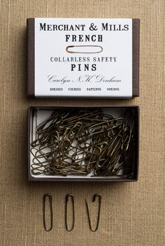 """French Safety Pins from Merchant & Mills: Traditional French Safety Pins do away with the usual coil (or """"collar"""") that catches on threads and fibers. These little beauties are ideal for knitters and sewists alike. Each perfectly formed pin is almost an inch long. $10.00"""