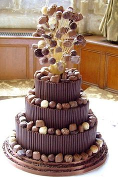 A chocolate truffle cake with chocolate pirouette cookies and a giant sugar and truffle cake topper!
