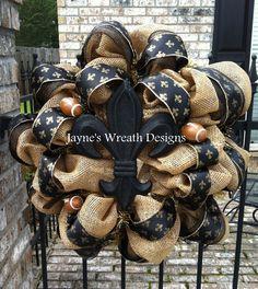 Saints football wreaths ~ Burlap, fleur de lis, footballs, and fleur de lis ribbon jayne's wreath designs  on fb