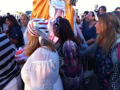 Women in brightly-hued dresses accompany the men leading the procession. Many pilgrims from France and elsewhere came to Djerba for the first time, as Tunisia tries to recover from a tourism slump in the aftermath of the nationwide uprising.