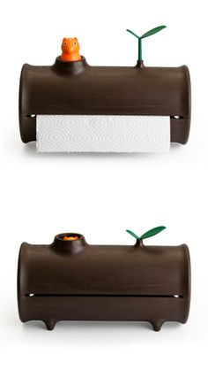 Log paper towel holder -  the squirrel pops out when a new roll is inserted, and slowly sink down as you use it.