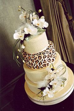 Animal print cake...do not like the flowers...but leopard is perfect for bridal party or engagement party!