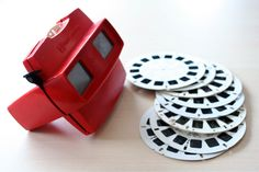 have a collection of an antique Viewmaster in black (Bakelite?) and many old reels... loved those things as a kid (1950s)