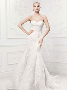 Truly Zac Posen tulle mermaid gown features contoured satin lattice detail and linear floral embroidery. Truly Zac Posen for David's Bridal Style ZP341419 #weddingdress #davidsbridal