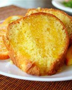 Orange Cake Ingredientes  Mudança Dose  1 pacote mistura de bolo amarelo  1 pacote pudim instantâneo limão  3/4 xícara de suco de laranja  1/2 xícara de óleo vegetal  4 ovos  1 colher de chá de extrato de limão  1/3 xícara de suco de laranja  2/3 xícara de açúcar branco  1/4 xícara de manteiga