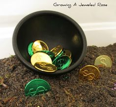 Hunting for treasure!  A fun St.  Patrick's Day activity, and great sensory play!  Very simple to set up too!