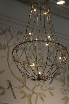 Could duplicate using a wire hanging basket and a wire lampshade-Swedish Room Trouvais