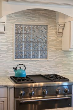 Tin Tile Back Splash! Love this idea and love the whole kitchen
