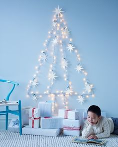 "String-Light ""Wall"" Tree                Use adhesive hooks to hang lights in a myriad of holiday shapes. Here, we created a Christmas tree, the perfect wintry decoration for your child's bedroom."