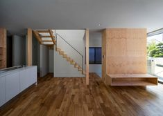 Interior shot of a glass-fronted Japanese home featuring a steeply angled roof.