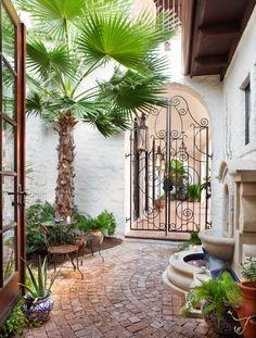 iron gate, fountain, cobblestone