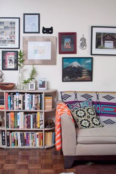 cute chevron blanket, pillow and couch but not a fan of the pictures on the wall.