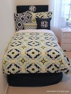 Add a monogrammed pillow to your bed to create a more personalized look.