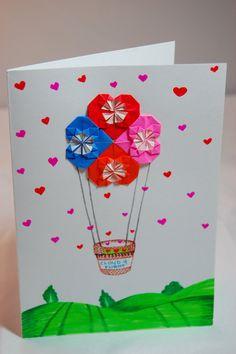Tarjeta con corazones de origami