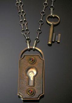 Jude Clarke: Little Sparrow, antique key-hole plate, sterling, gold, photo, garnets