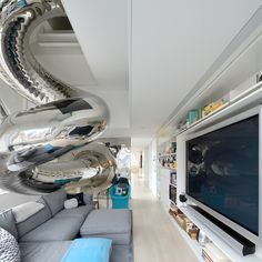 80-foot slide in an NYC penthouse designed by David Hotson