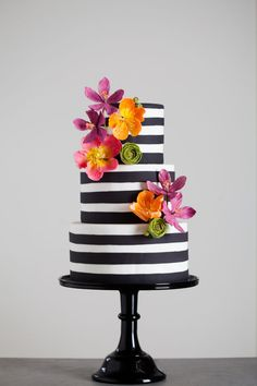 Black and white stripes with bright sugar flowers Wedding Cake