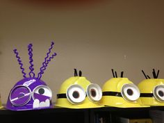Minion hats!  supplies: Construction hats from Party City, glasses are cut from silver paper party cups and skinny black duct tape, eyes are construction paper, burn holes in hat with glue gun and insert chenille stems for hair - covering ends inside with a piece of duct tape (so they don't poke!). It cost me about $25 to make 9 hats.
